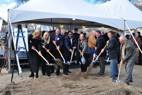 Groundbreaking attendees shovel earth in a ceremony to kick off construction for the Stacie Mathewson Community Wellness Center in January 2015.