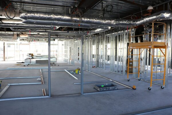 Construction workers begin to create the room frames for the second floor Wellness Pod.